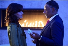 Carla Gugino accepts a token of appreciation from  Giancarlo Esposito in JETT for Cinemax